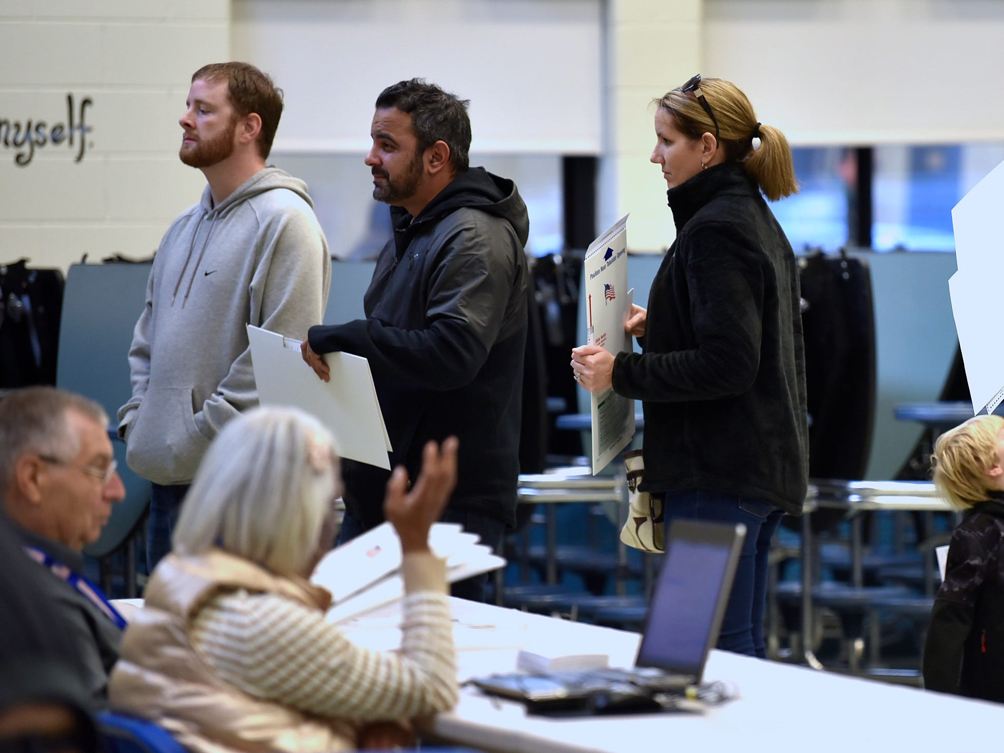 Voters cast their ballots at Macomb Township Precincts 12 and 30 in the cafeteria at Ojibwa Elementary School on Tuesday.