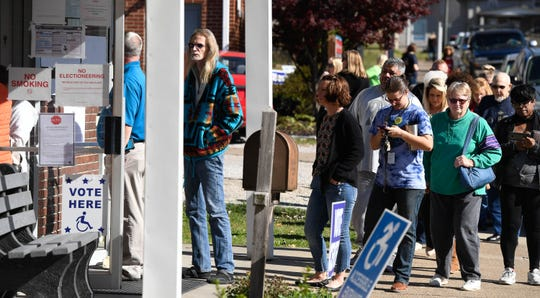 Voters lined up outside of the St. James West voting center Tuesday around noon, November 6, 2018.
