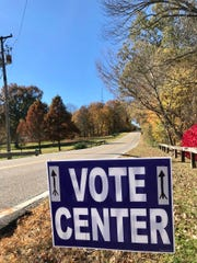 Signs direct votes to the county's newest polling location, Burdette Park's Discovery Lodge.