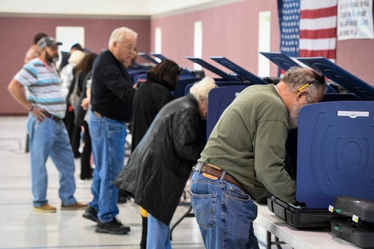 Voters casting ballots at the St. James West voting center Tuesday around noon, November 6, 2018.