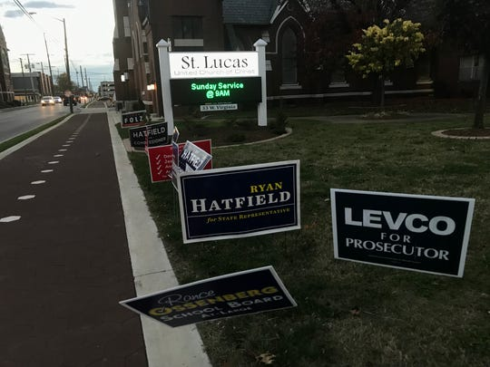 Signs sit out front of St. Lucas United Church of Christ nearing the end of voting Tuesday.
