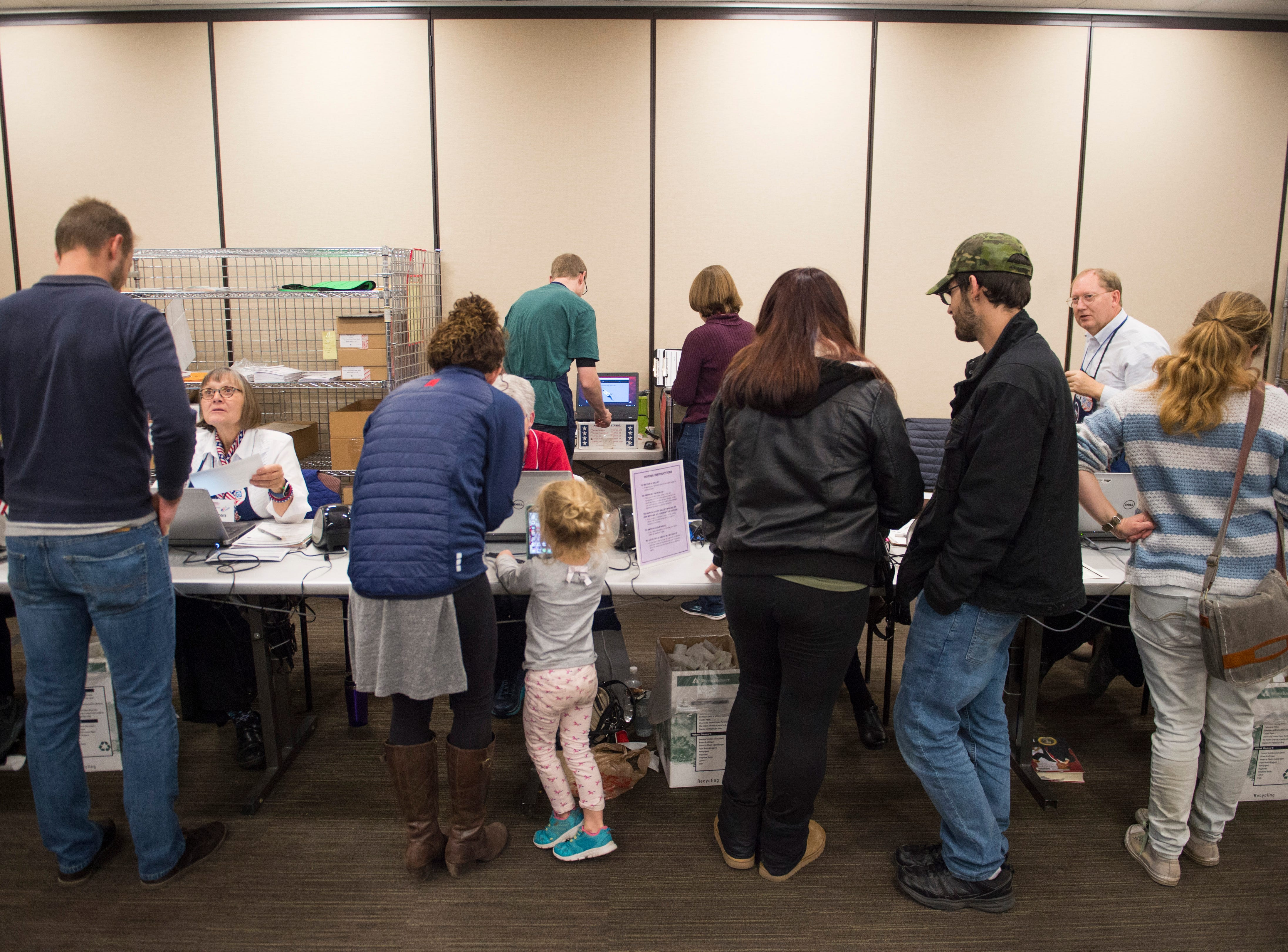 Volunteers work to check-in a steady stream of voters at the Larimer County Courthouse on Election Day, Monday, November 6, 2018.