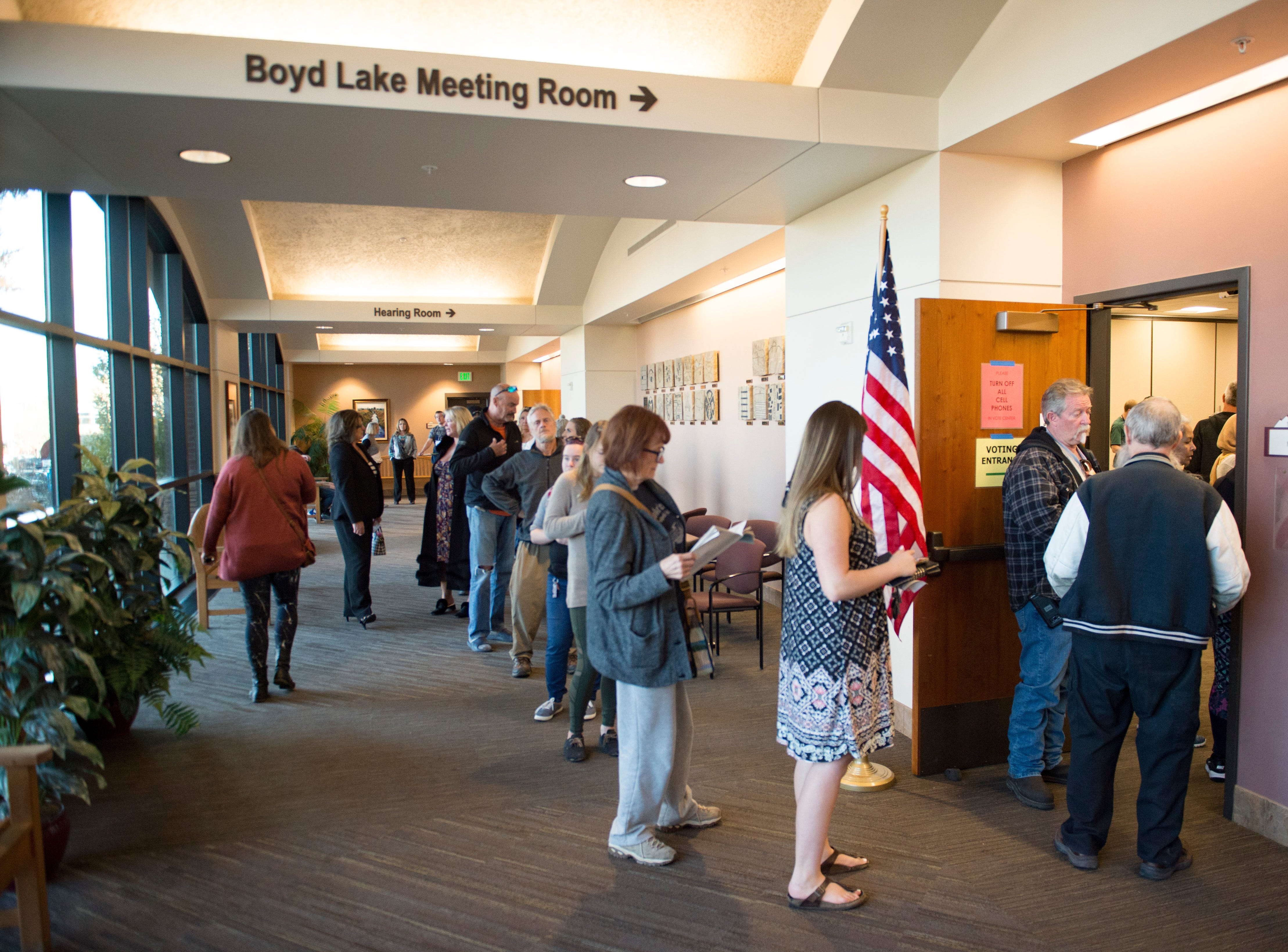 Voters wait in line to cast their ballot at the Larimer County Courthouse on Election Day, Monday, November 6, 2018.