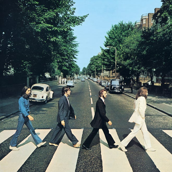 """The famous """"Abbey Road"""" cover: The Gravedigger, The Corpse, The Undertaker, The Angel. Otherwise known as George Harrison, Paul McCartney, Ringo Starr, John Lennon"""