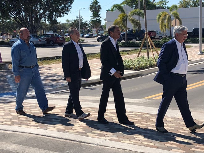 """Doing their best impression of the famous Beatles' Abbey Road photo are, from left, Cape Coral mayor Joe Coviello (George Harrison), Cape Coral City Manager John Szerlag (Paul McCartney), Realtor and business owner Elmer Tabor (Ringo Starr) and former Cape Coral mayor Joe Mazurkiewicz (John Lennon). They are crossing newly renovated Southeast 47th Terrace to help promote the """"Catch the Vision"""" event on , which highlights new projects in the city."""