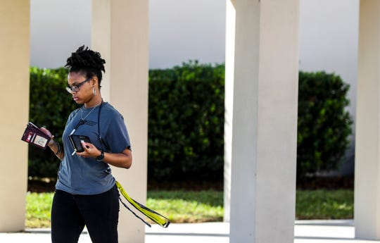 Marissa Houston, 22, heads to her car after voting for the first time. Voters head in and out of Precinct 9 sign in Fort Myers as they exercise their right to vote.