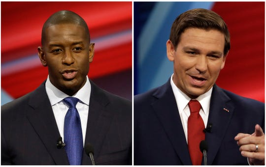 In this combination of Oct. 21, 2018 file photos Florida Democratic gubernatorial candidate Andrew Gillum, left, and Florida Republican gubernatorial candidate Ron DeSantis speak during a CNN debate in Tampa.