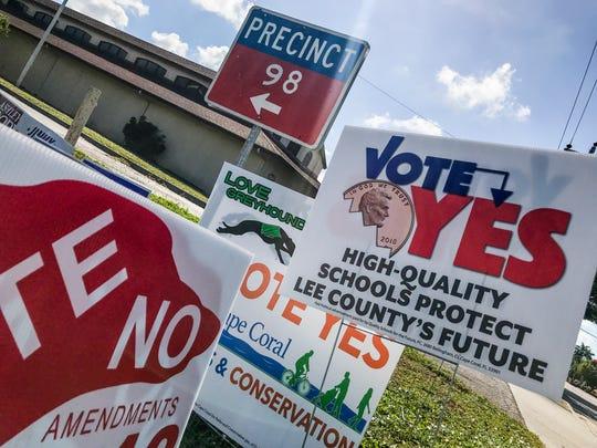 Political signs surround the Precinct 98 sign in Cape Coral.