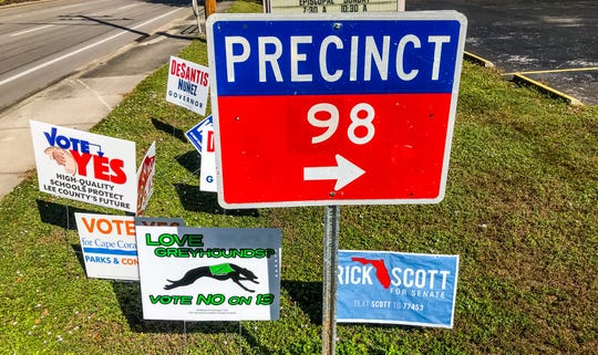 Political signs surround the Precinct 98 sign in Cape Coral.
