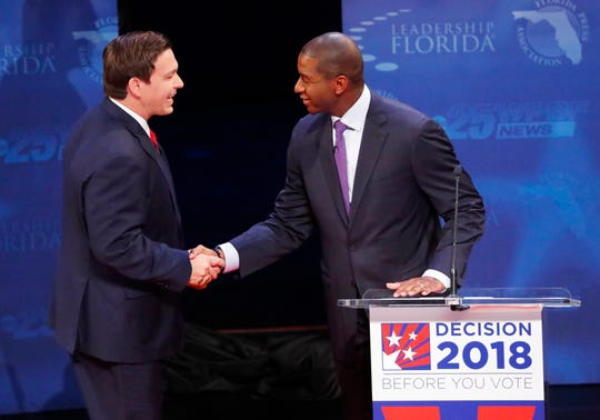 Florida gubernatorial candidates, Republican Ron DeSantis, left, and Democrat Andrew Gillum shake hands before a debate, Wednesday, Oct. 24, 2018, at Broward College in Davie, Florida.