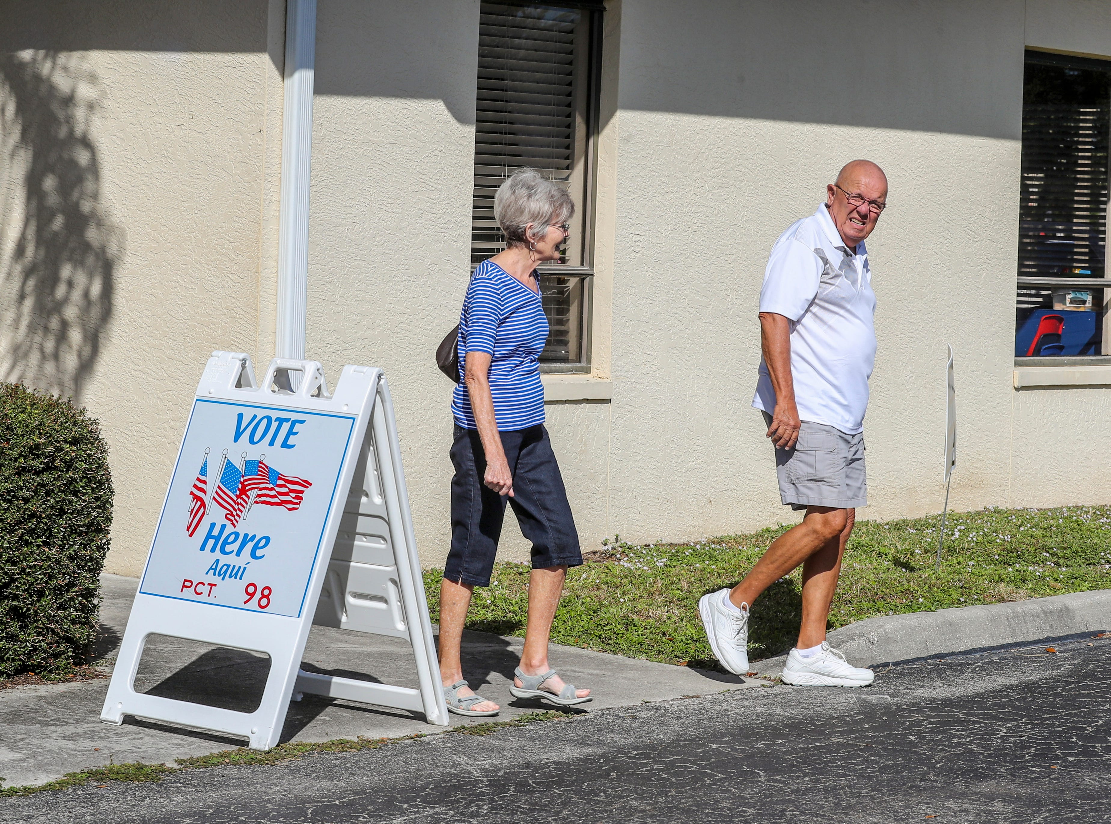 Voters head to their cars after voting at Precinct 98 in Cape Coral.