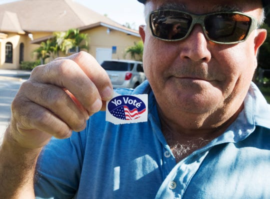 """Jose Rivera shows off his """"I voted"""" sticker after casting his ballot at Precinct 7 off of Palm Beach Boulevard on Tuesday Nov. 6, 2018."""
