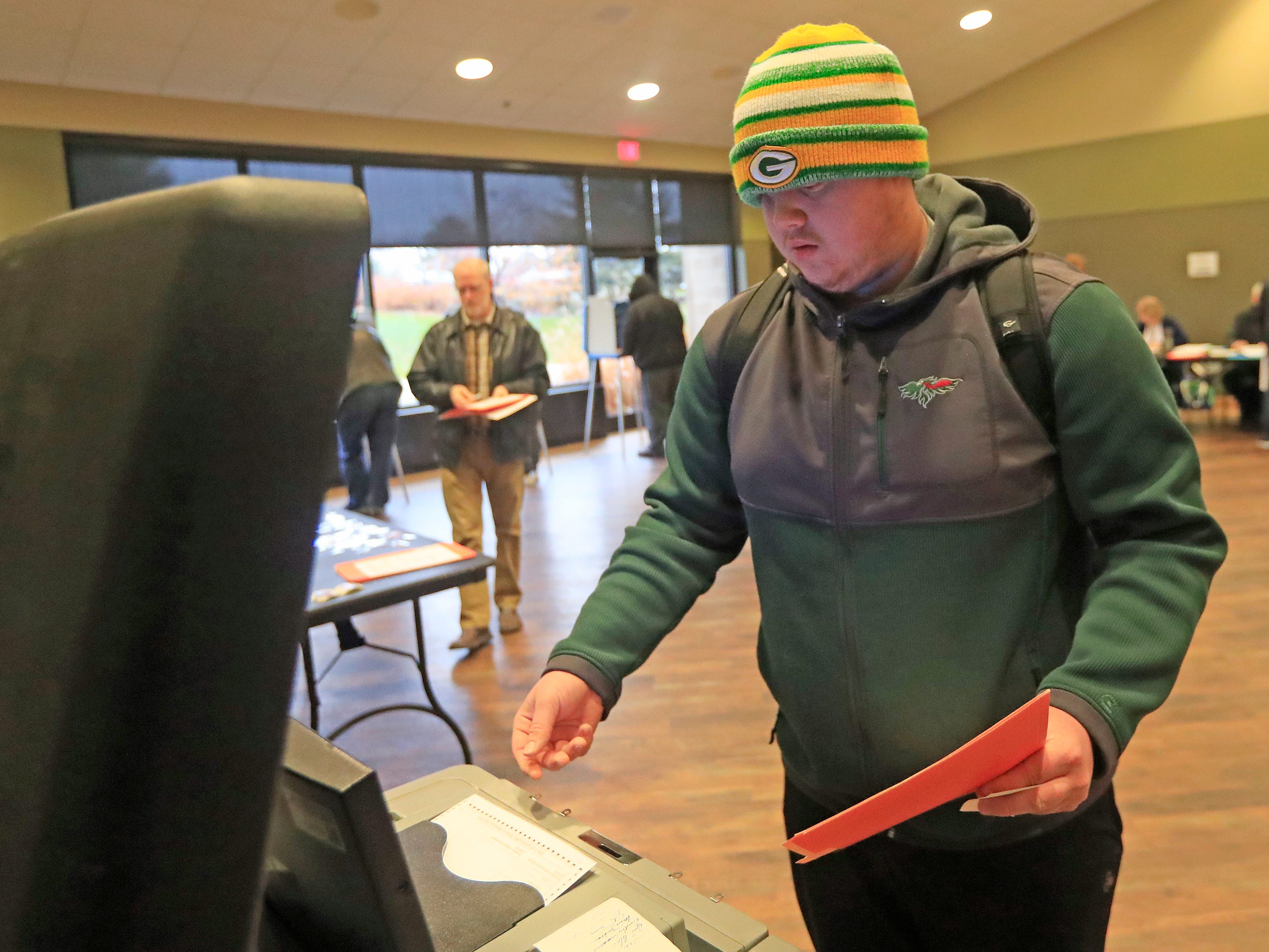 UW-Green Bay student Chad Schneider casts his ballot after registering to vote at the UW-Green Bay campus on Tuesday, November 6, 2018, in Green Bay, Wis.
