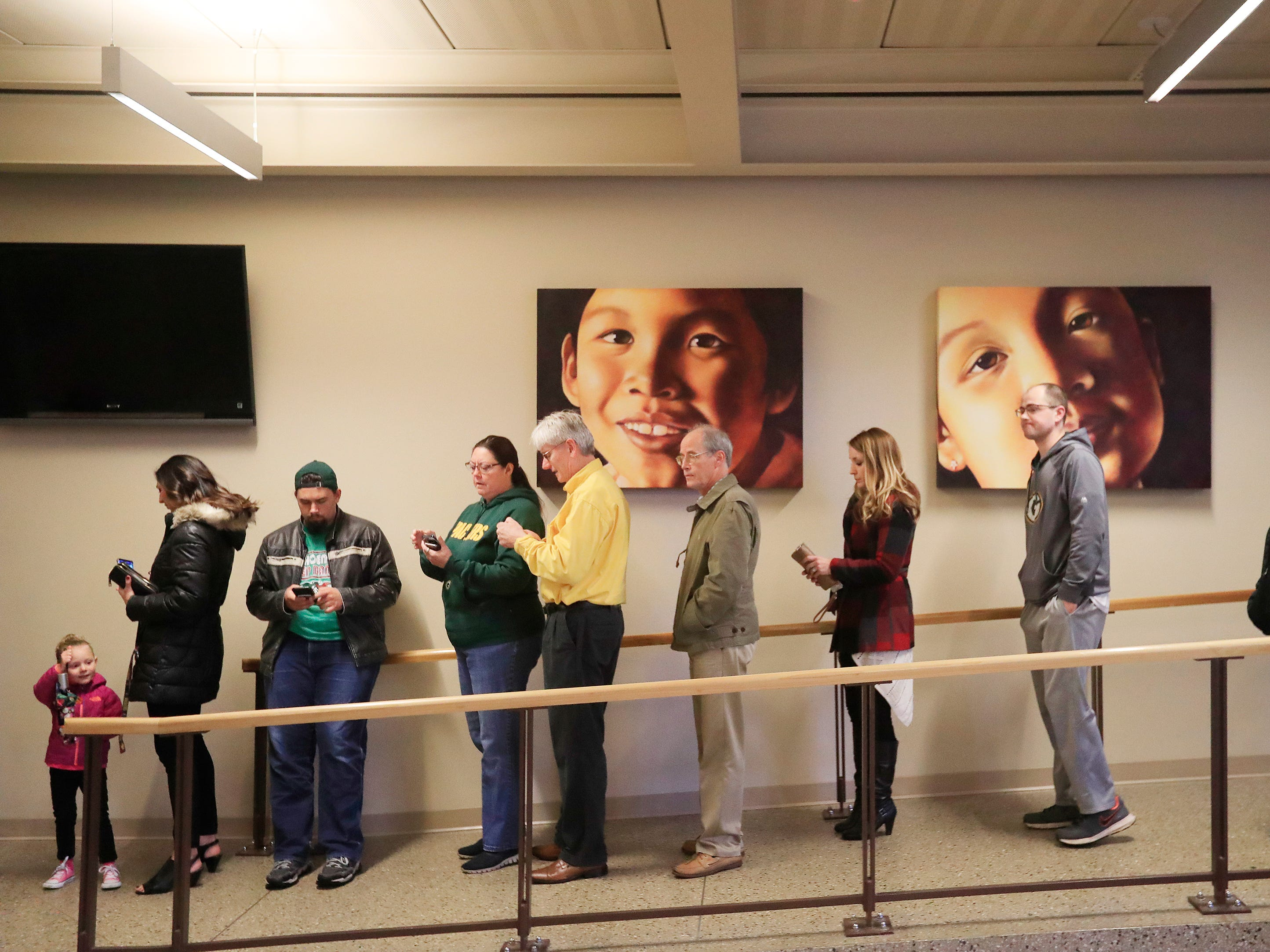Voters line up to cast their ballots at the UW-Green Bay campus on Tuesday, November 6, 2018, in Green Bay, Wis.