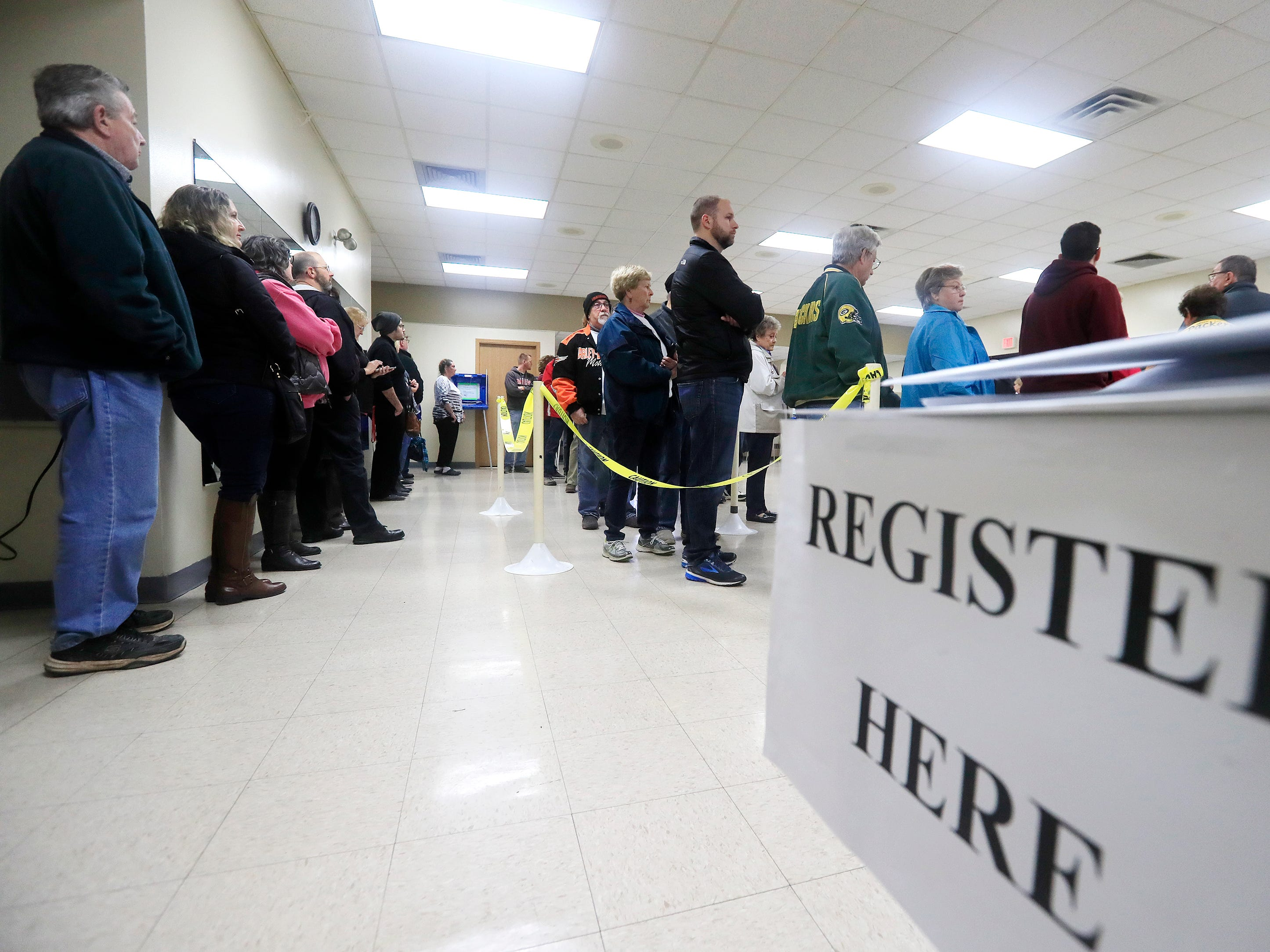 Voters wait in line to cast their ballots at the Bellevue Community Center on Tuesday, November 6, 2018 in Bellevue, Wis.