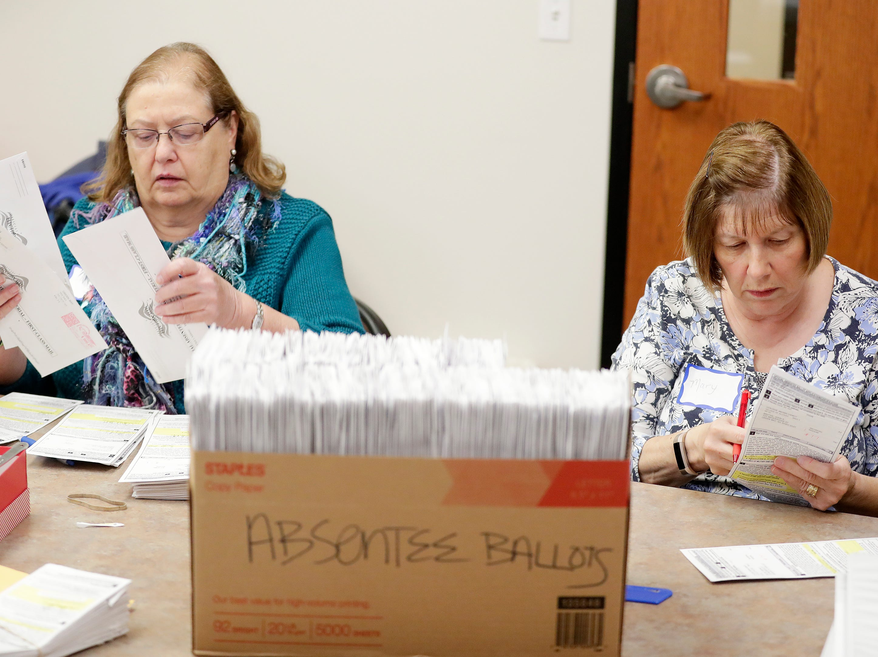 Election workers Diane Klepp and Mary Schroeder process absentee ballots at Allouez Village Hall on Tuesday, November 6, 2018 in Allouez, Wis.