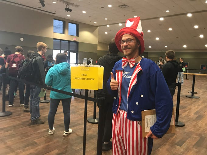Avir Waxman, 22, greeted voters at the University of Wisconsin-Oshkosh as Uncle Sam. Waxman is a field organizer for NextGen Wisconsin, part of NextGen America,  a program that works to get   young voters to the polls.
