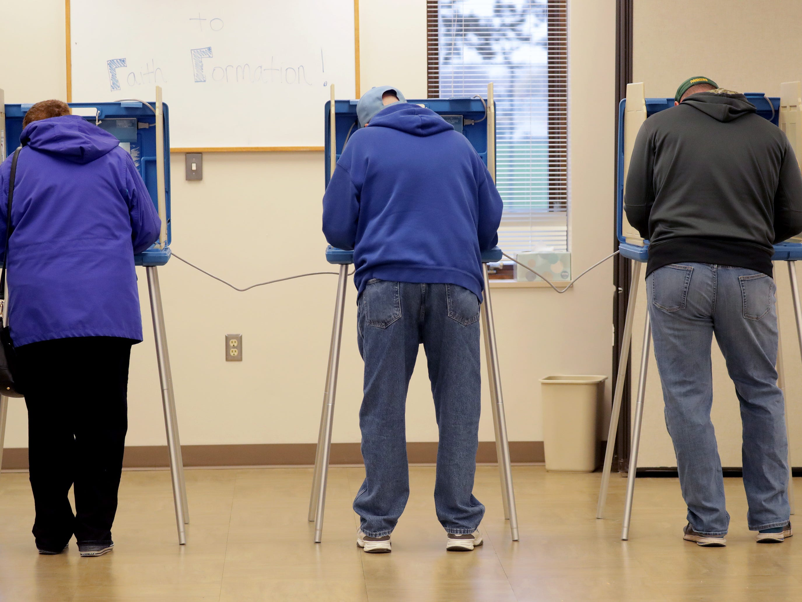 Voters cast their ballots in the midterm elections at Prince of Peace Lutheran Church on Tuesday, November 6, 2018, in Appleton, Wis.