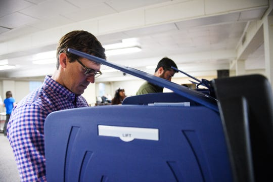 Oliver Lollis casts his vote at Augusta Road Baptist Church on Tuesday, Nov 6, 2018.