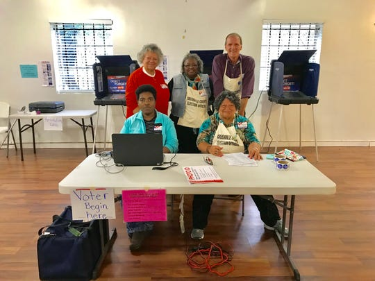 Poll workers pose for a group photo at Pilgrim Rest Baptist Church in Greenville