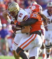 Clemson linebacker Jalen Williams (30) brings down Boston College tight end Tommy Sweeney (89) during the 3rd quarter on Saturday, September 23, 2017 at Clemson's Memorial Stadium.