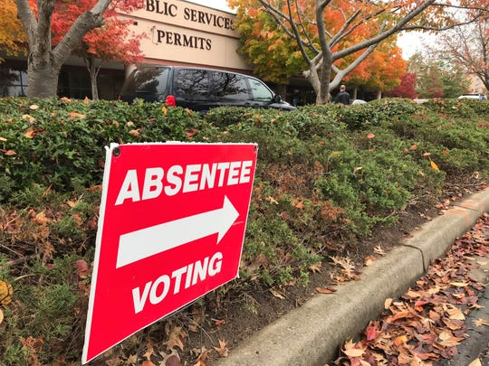 Voters in Accomack and Northampton counties are being urged to vote absentee via mail in the town elections now set for May 19.