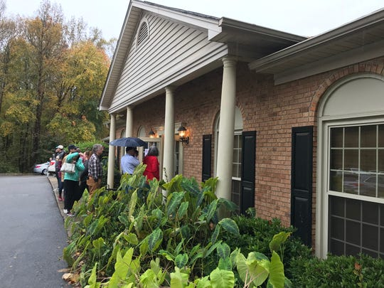 Voters stand in line at Forrester Woods clubhouse waiting to vote in the 2018 midterm elections.
