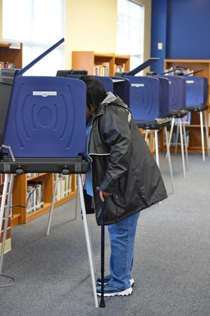 Voters from across the area cast their votes Tuesday, Nov. 6, 2018. Polling station JL Mann High School.