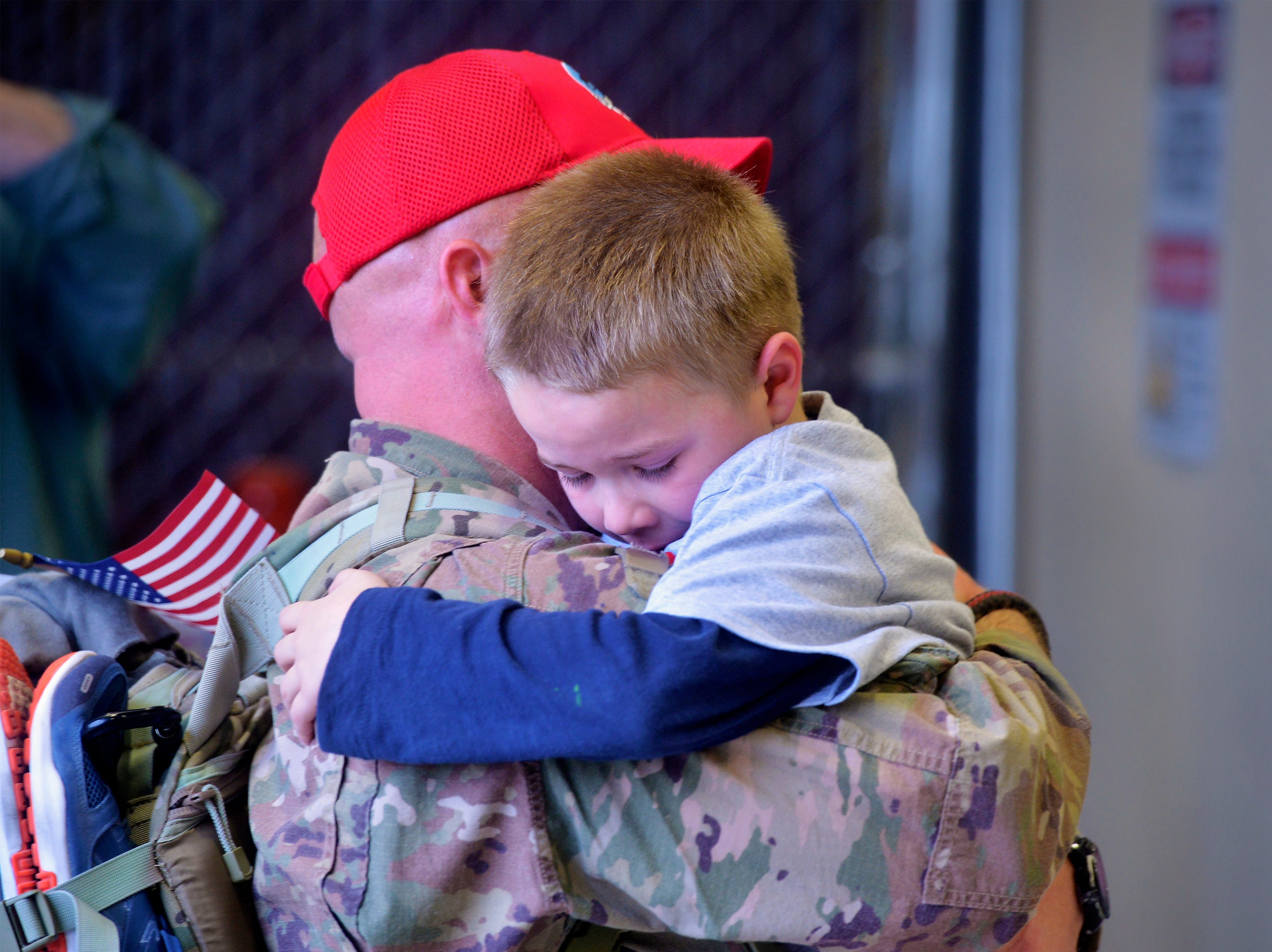 Kieran Bekoff, age 7, hugs his father, Chief Master Sergeant Anthony Bekoff, who returned home on Monday afternoon after a seven month deployment with the 819th Red Horse Squadron to the country of Niger in Africa.  100 members of the 819th Red Horse Squadron were welcomed home by family and friends at a hanger on Malmstrom Air Force Base.