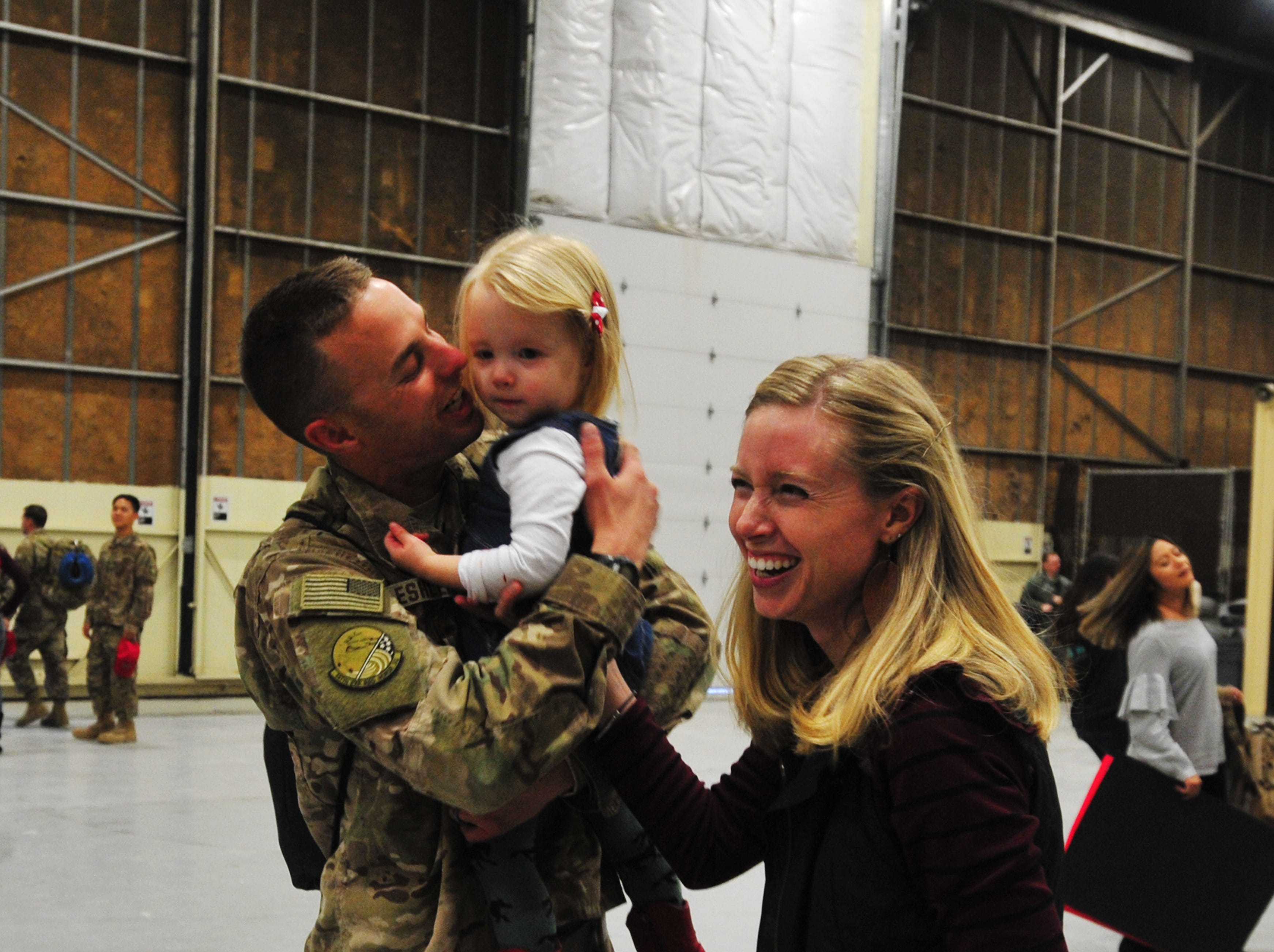 100 members of the 819th Red Horse Squadron are welcomed home by family and friends in a hanger at  Malmstrom Air Force Base, Monday afternoon, after a seven month deployment to the African country of Niger.