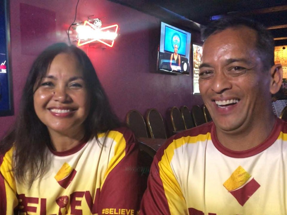 Write-in candidates Alicia Limitiaco and Frank Aguon Jr. smile at their election night headquarters at the Cliff Hotel in Agana Heights.
