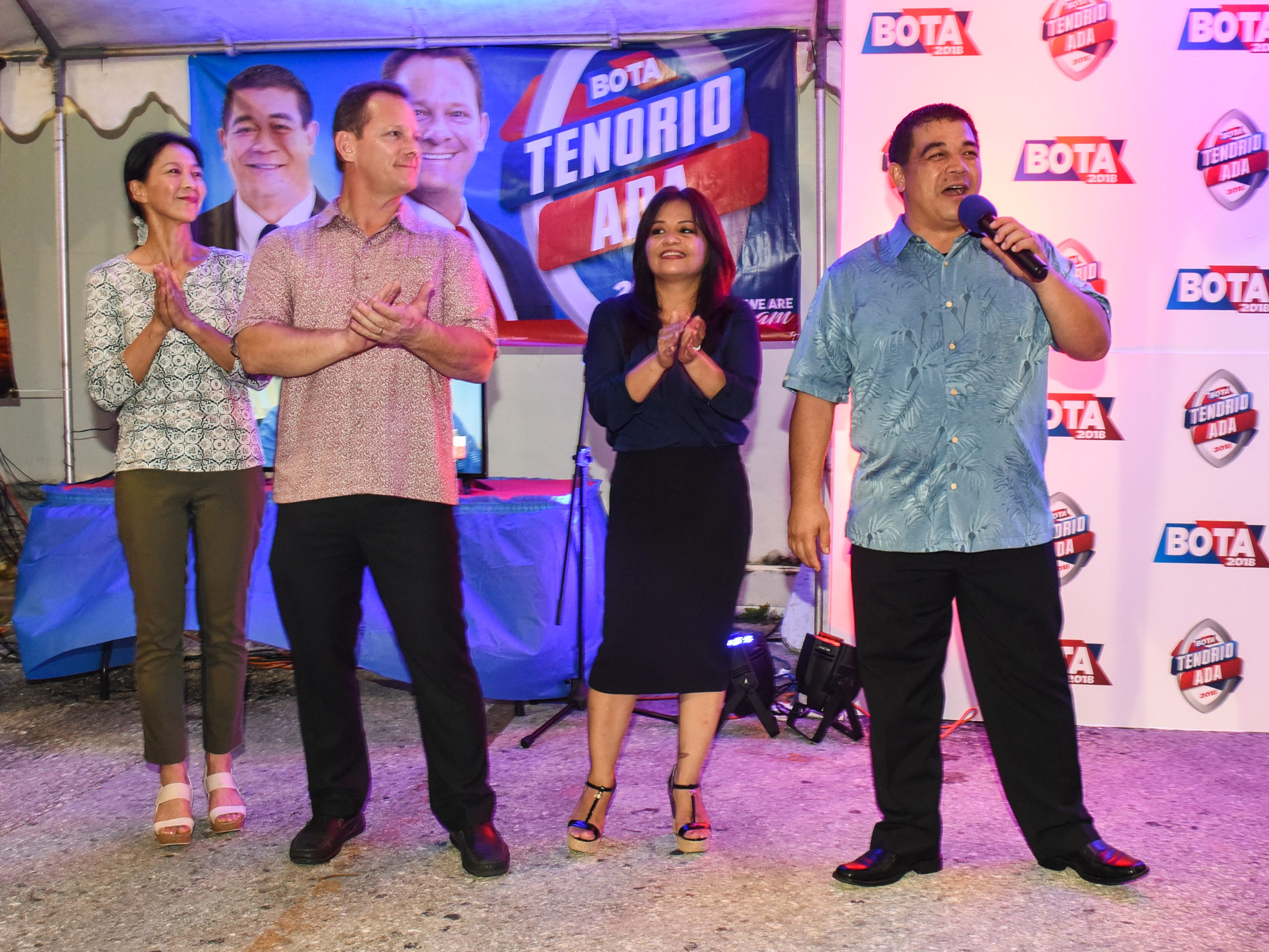Republican candidate for lieutenant governor, Sen. Tony Ada, right, speaks to supporters with his wife, Annette, at his side as well as gubernatorial candidate, Lt. Gov. Ray Tenorio and Madoka Tenorio, during the early morning hours of Wednesday, Nov. 7, 2018, at the team's campaign headquarters in Tamuning.