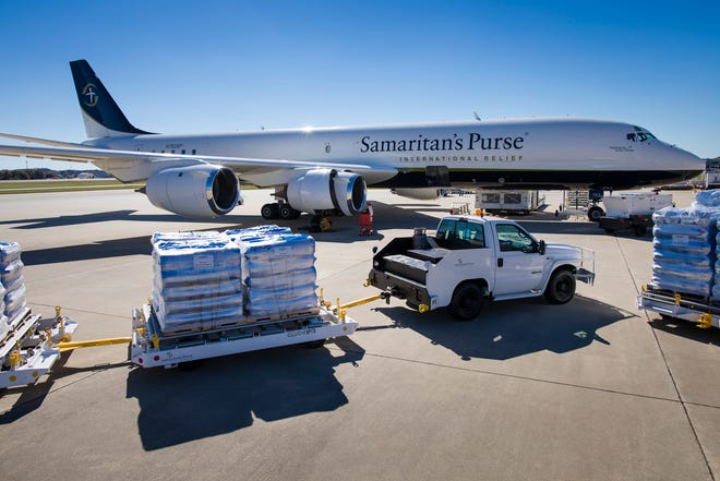 GREENSBORO, N.C., Nov. 3, 2018—Samaritan's Purse staff load emergency shelter materials, household water filtration units, solar lights and medical supplies aboard the organization's DC-8 cargo aircraft at Piedmont Triad International Airport, in preparation for an airlift to aid victims of Typhoon Yutu in the Northern Mariana Islands of Saipan and Tinian.