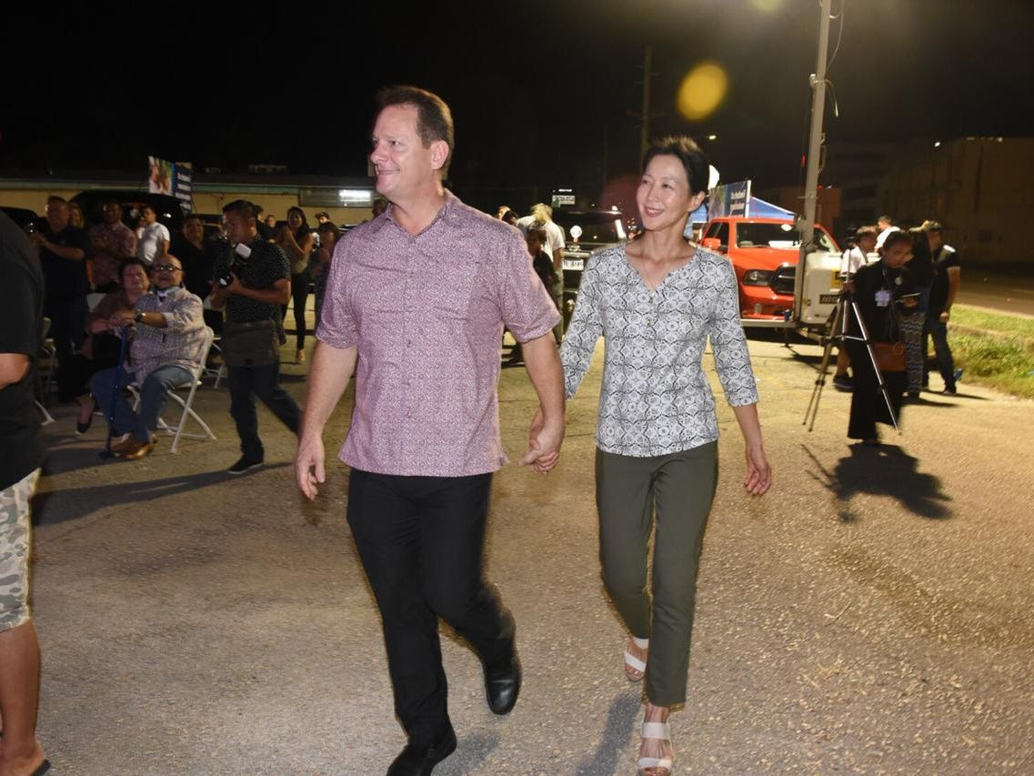 Lt. Gov Ray Tenorio and his wife walking to the stage of his general election headquarters.