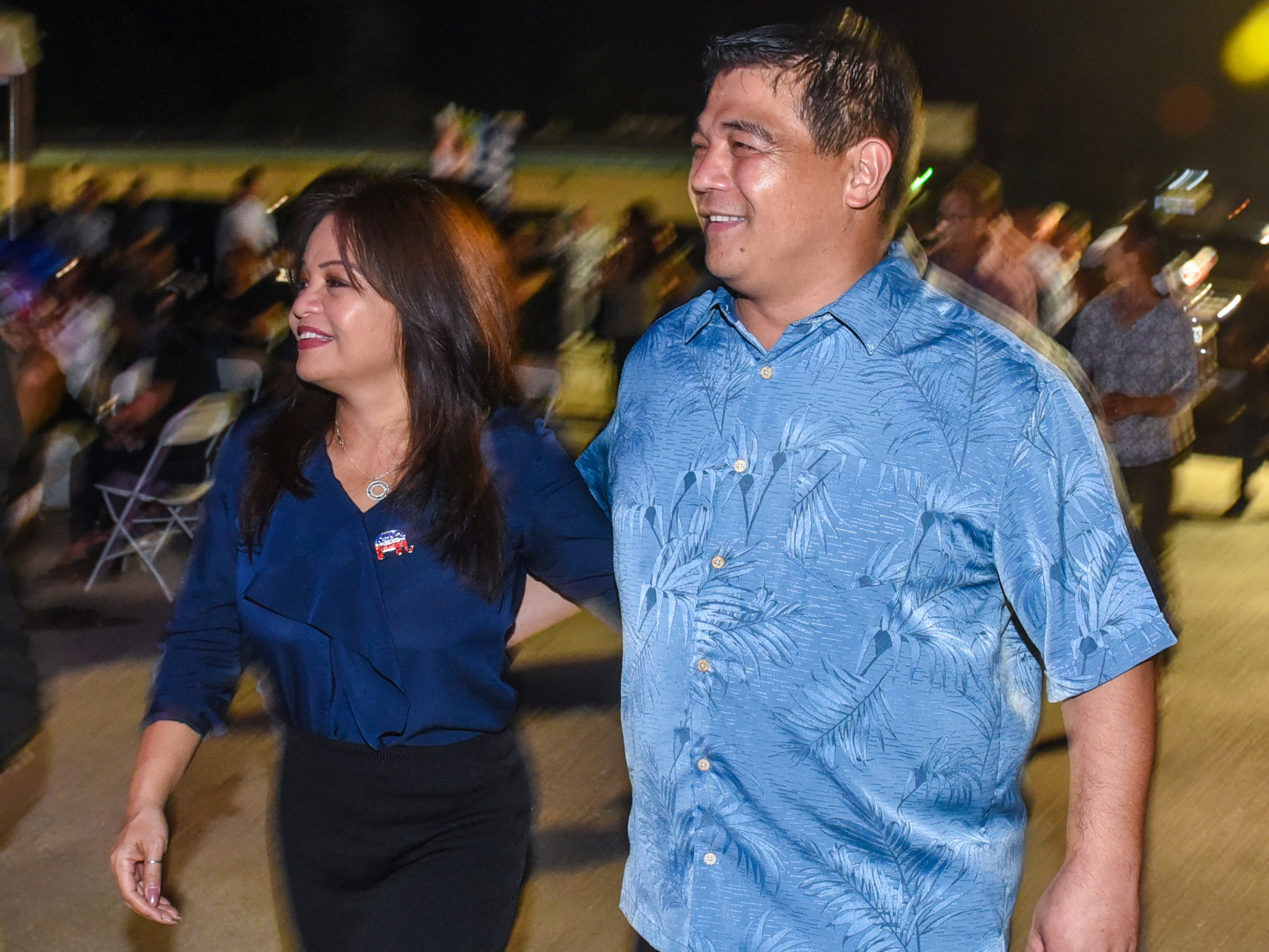 Republican candidate for lieutenant governor, Sen. Tony Ada, and his wife, Annette, prepare to address supporters at the Republican gubernatorial campaign headquarters in Tamuning during the early morning hours of Wednesday, Nov. 7, 2018.