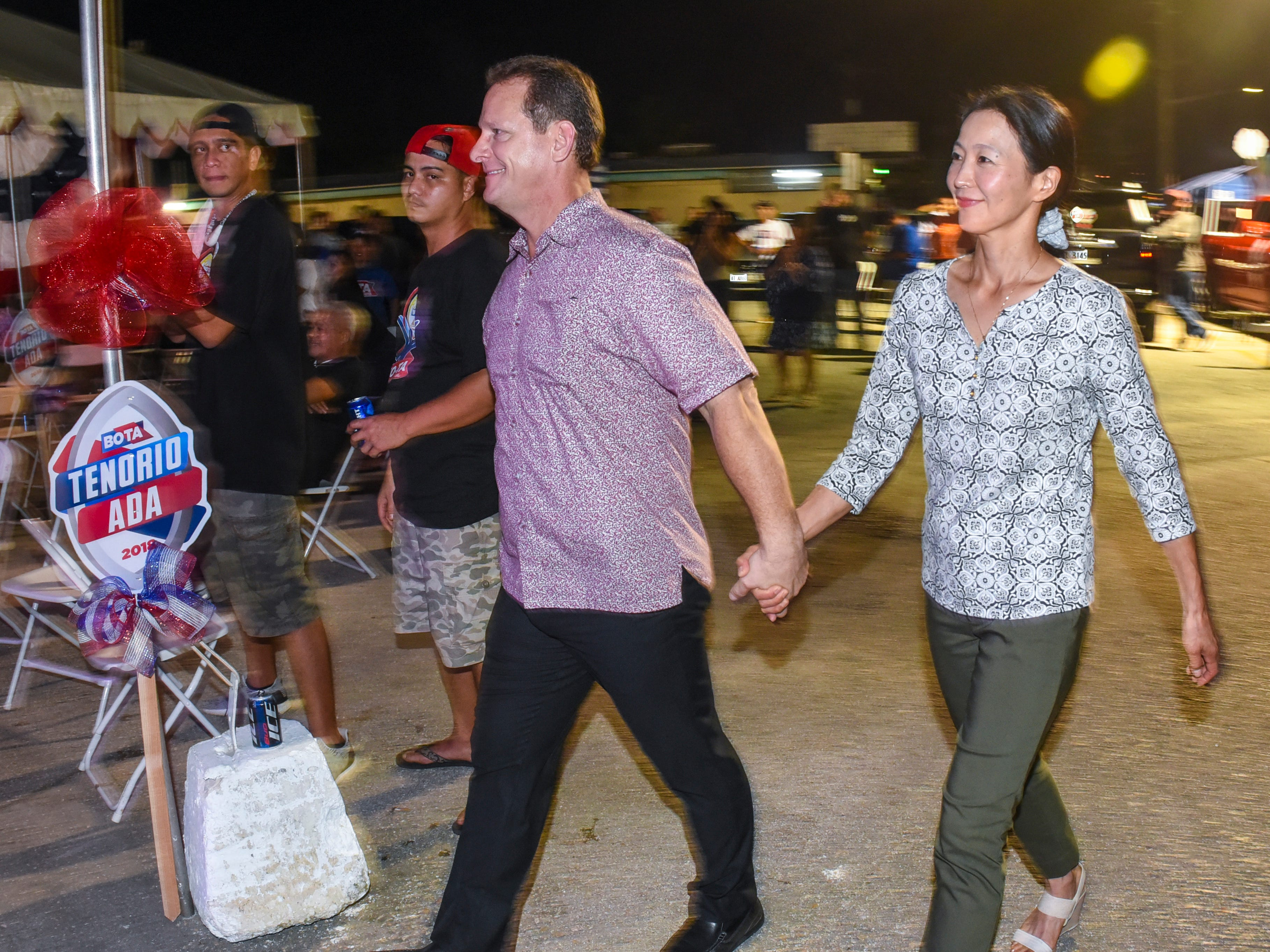 Republican gubernatorial candidate, Lt. Gov. Ray Tenorio, and his wife, Madoka, prepare to address supporters at the team's campaign headquarters in Tamuning during the early morning hours of Wednesday, Nov. 7, 2018.