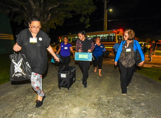 Precinct officials arrive with ballot boxes at the Guam Election Commission tabulation site at the University of Guam Calvo Field House in Mangilao in this Nov. 6, 2018, file photo.