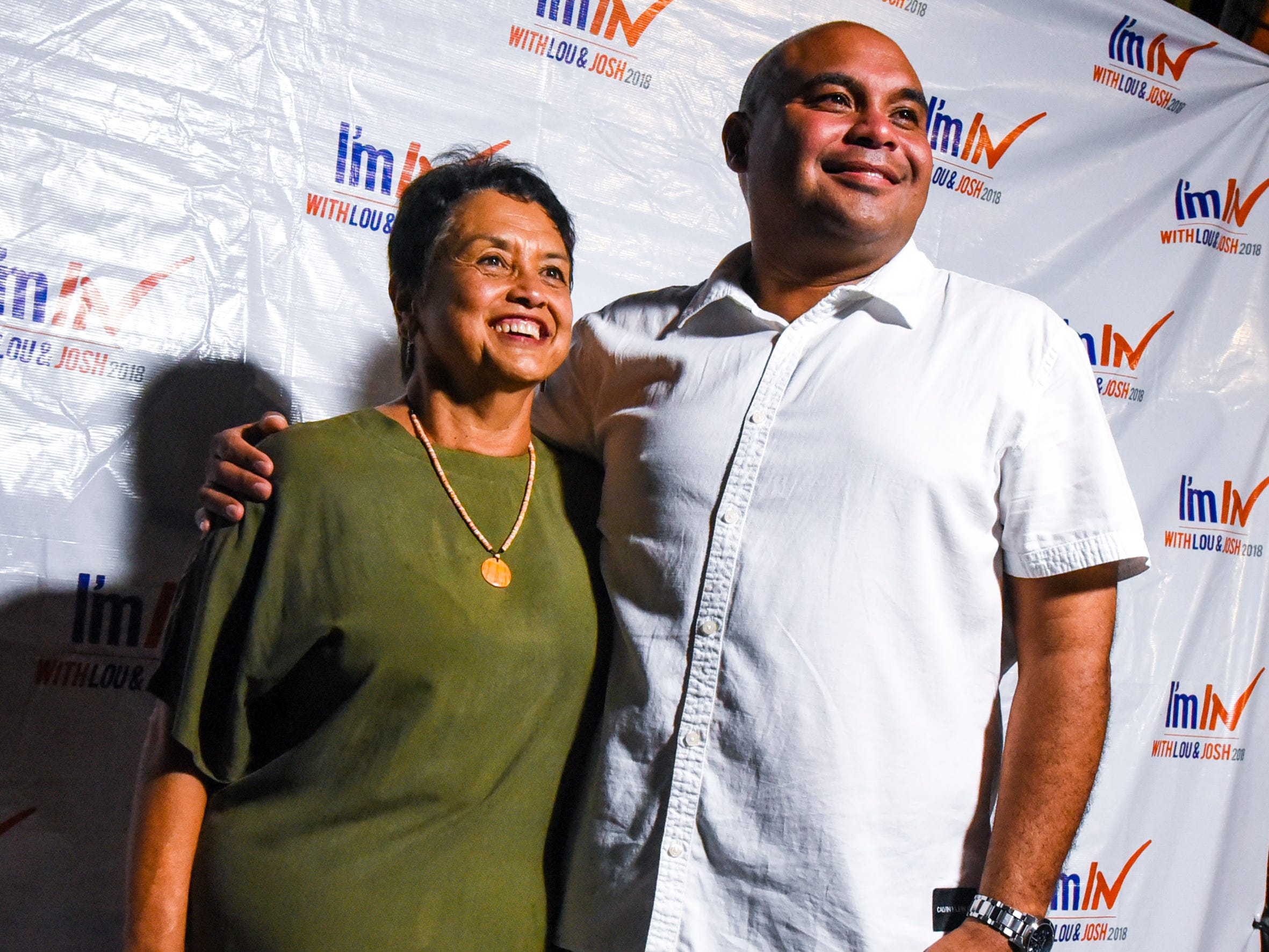 Democratic gubernatorial candidate, Lou Leon Guerrero, and her running mate, Joshua Tenorio,  gather for a phtoo at the team's campaign headquarters in Hagåtña during the late evening hours of Tuesday, Nov. 6, 2018.