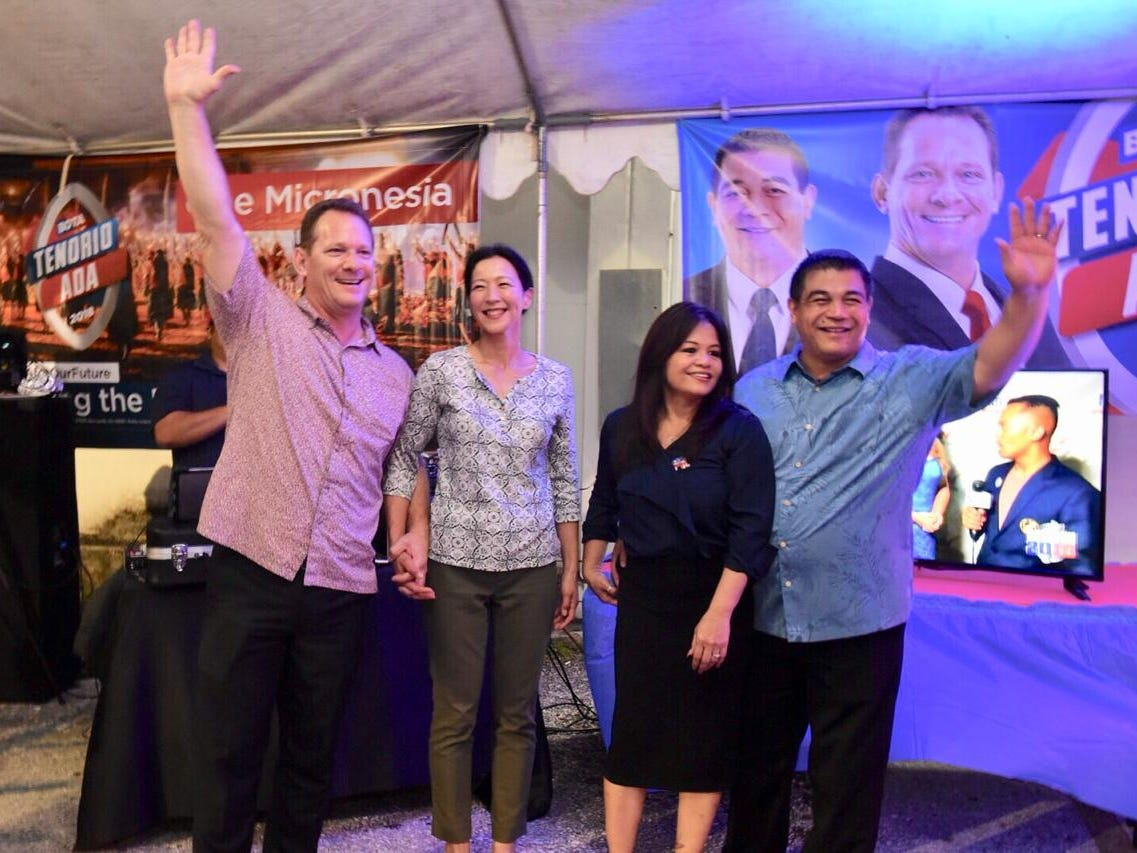 Lt. Gov Ray Tenorio and Tony Ada wave to BOTA crowd at the Tenorio-Ada headquarters.