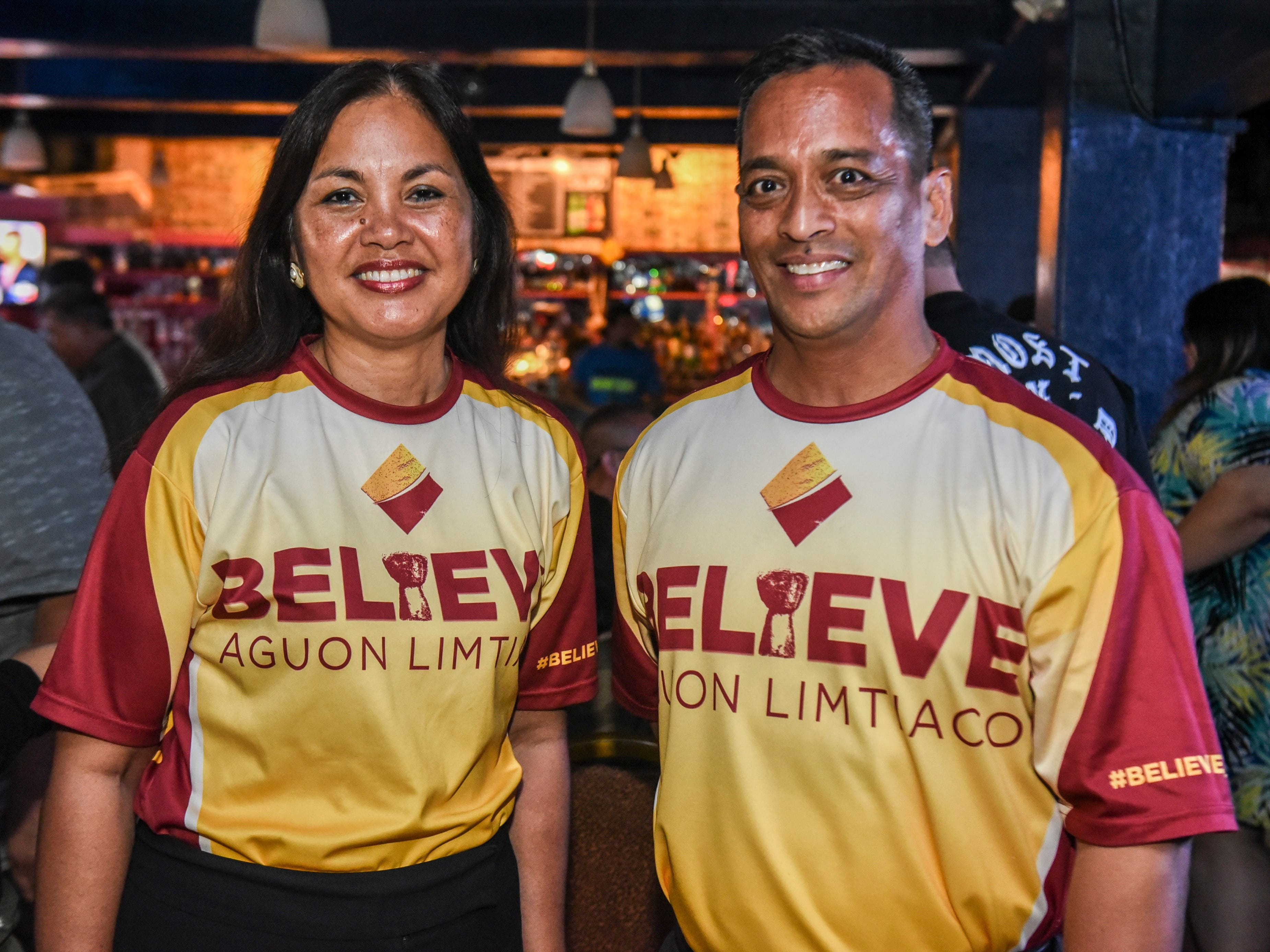 Write-in gubernatorial candidates, Sen. Frank Aguon Jr, right, and his running mate, Alicia Limtiaco, come together for a photo in Agana Heights, during the early morning hours, as they and their supporters wait for election returns to be announced.