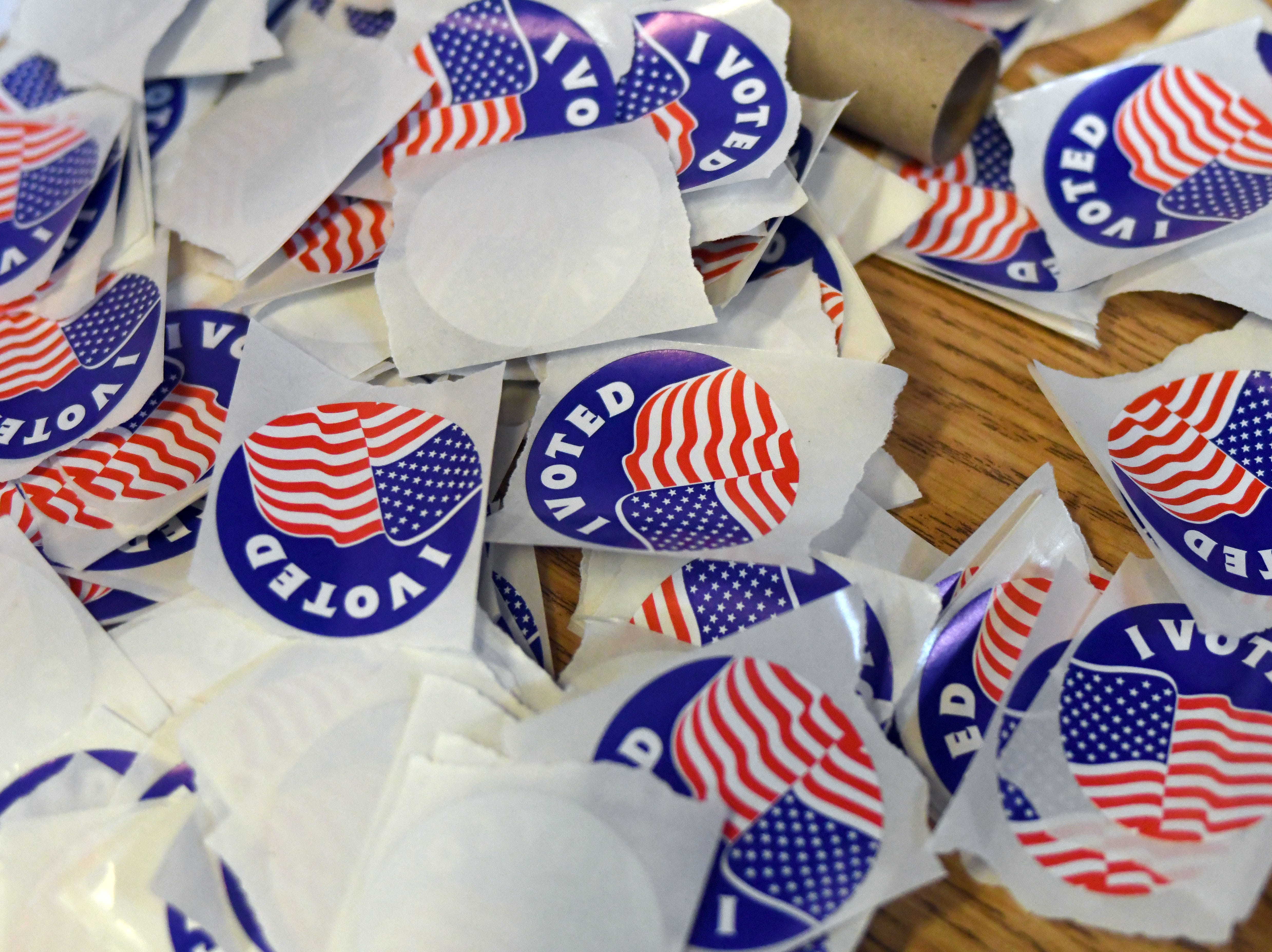 """A collection of """"I Voted"""" stickers wait to be taken as Hattiesburg residents come to vote at the Kamper Park precinct on Tuesday, November 6, 2018."""