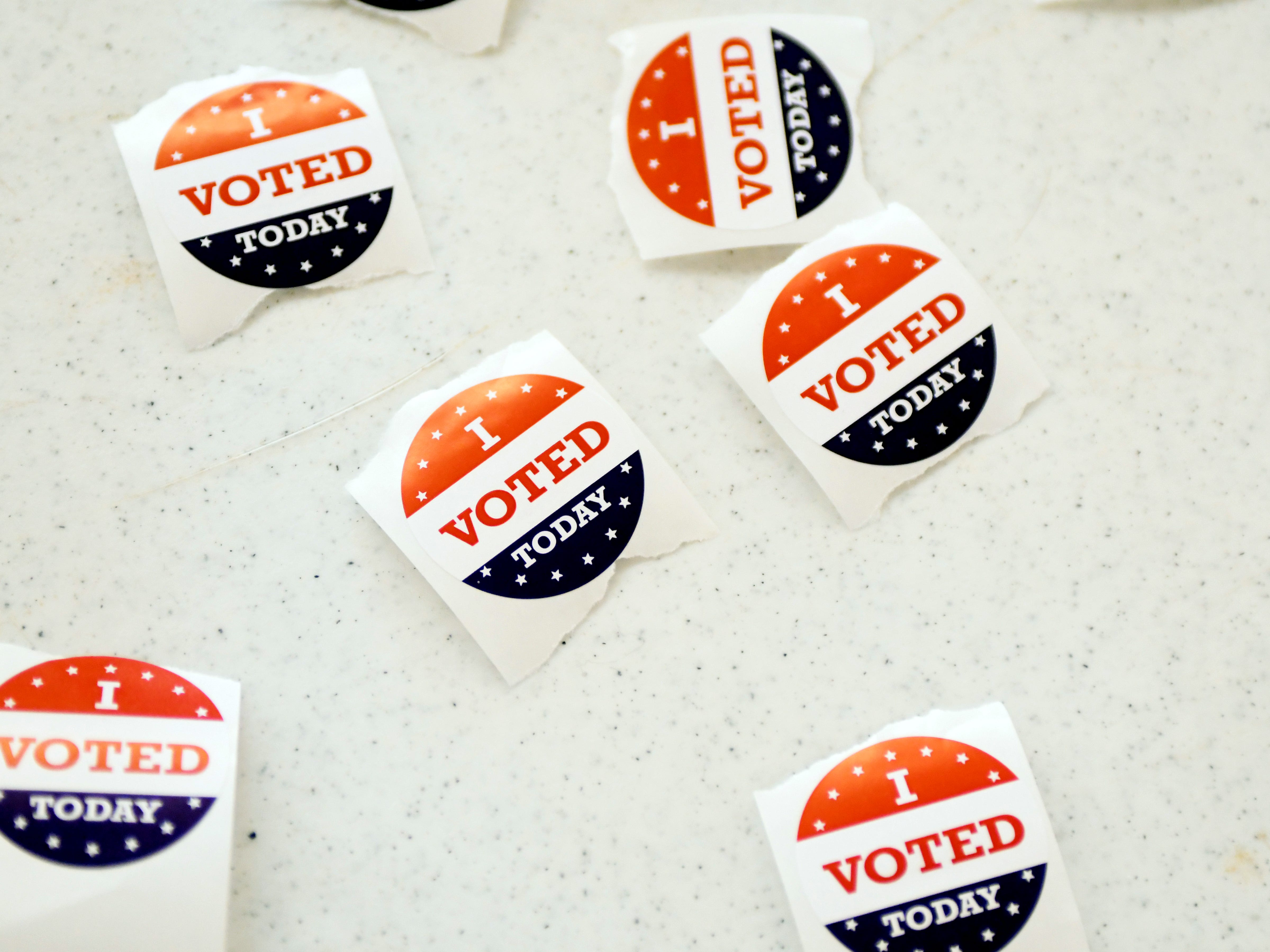 """A collection of """"I Voted"""" stickers wait to be taken as Hattiesburg residents come to vote at the Lake Serene precinct on Tuesday, November 6, 2018."""