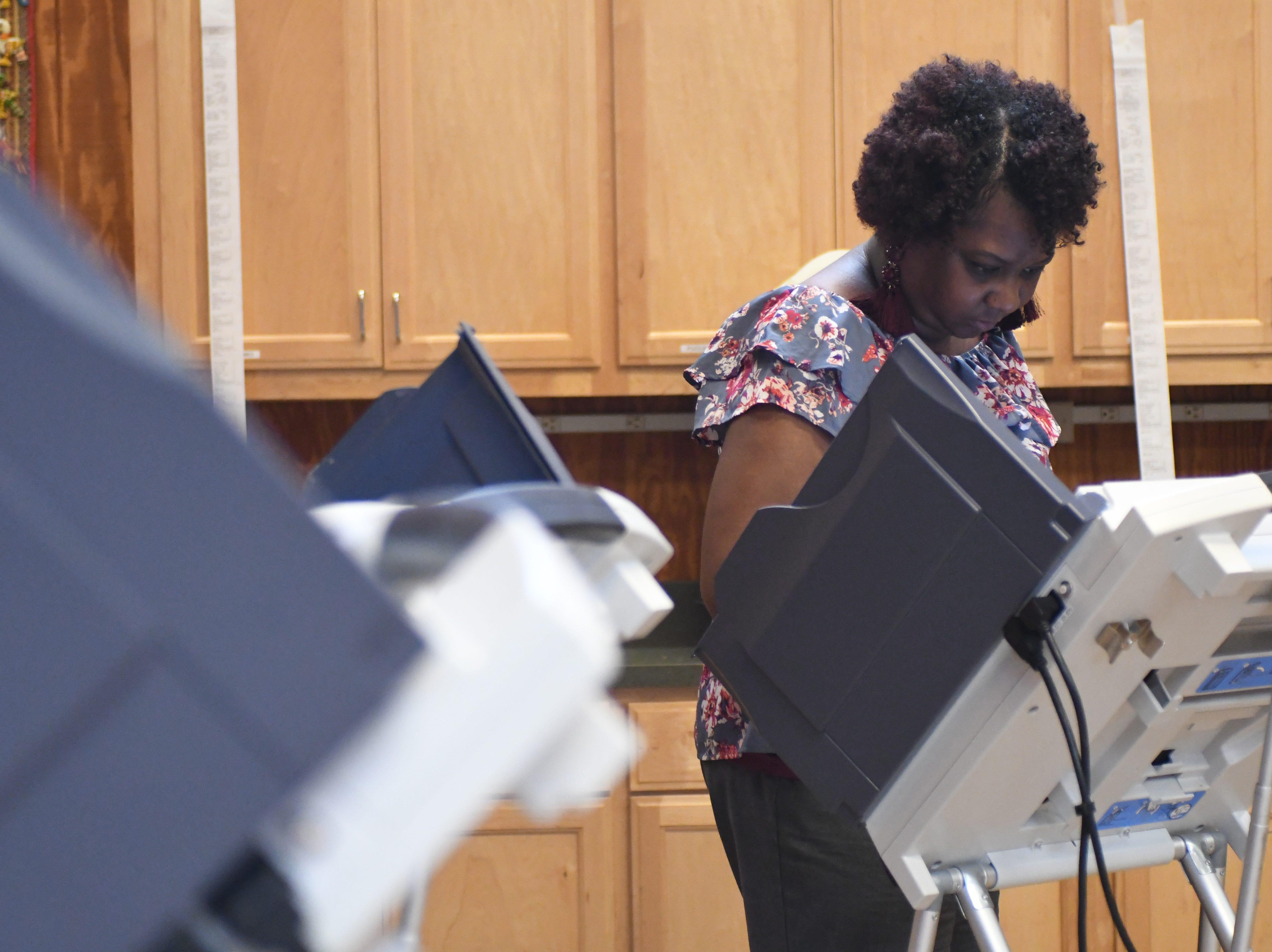 Hattiesburg resident Felisha Toney cast her ballot during the midterm elections at the Kamper Park precinct on Tuesday, November 6, 2018.