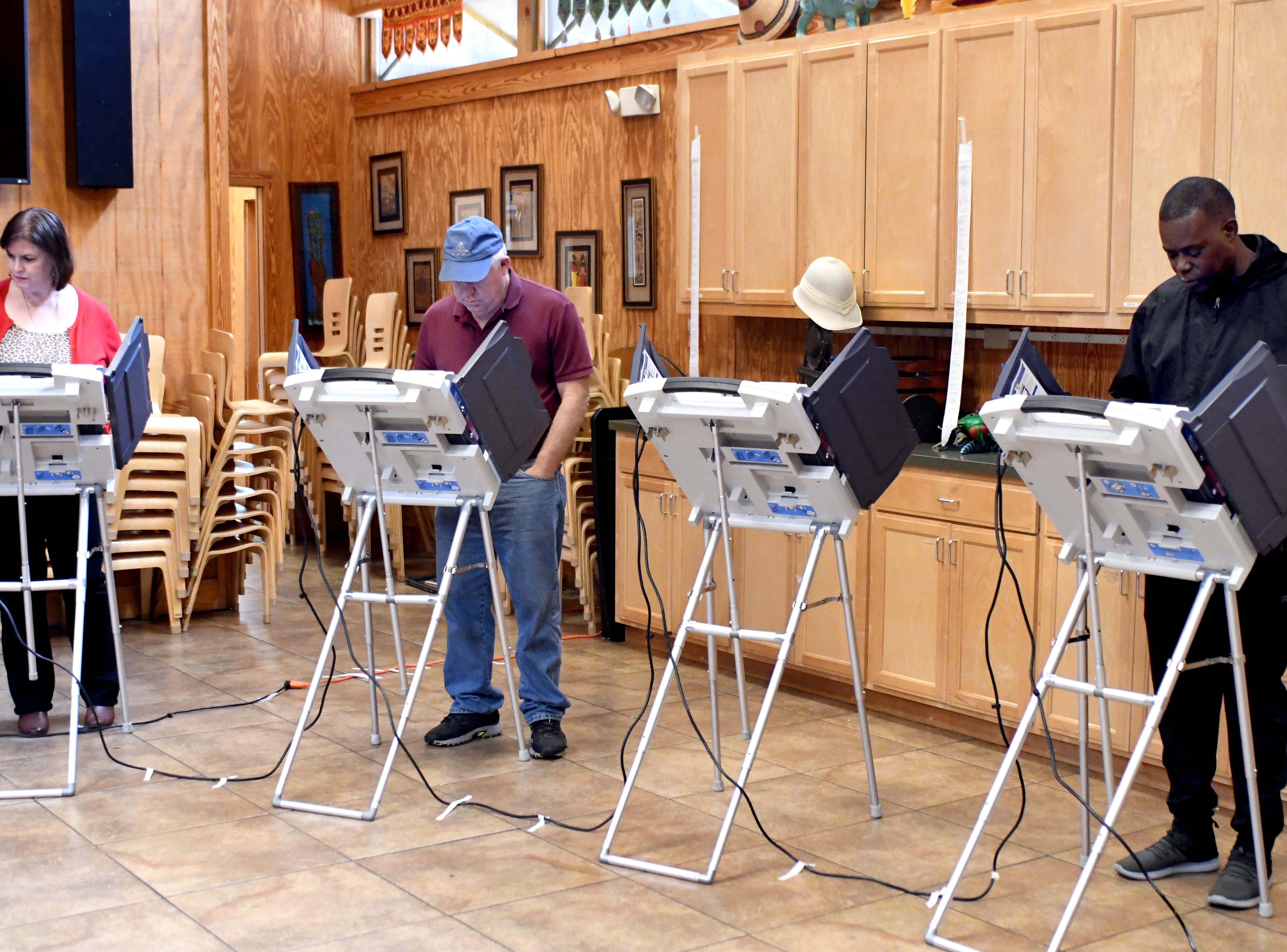 Hattiesburg resident cast their vote during the midterm elections at the Kamper Park precinct on Tuesday, November 6, 2018.