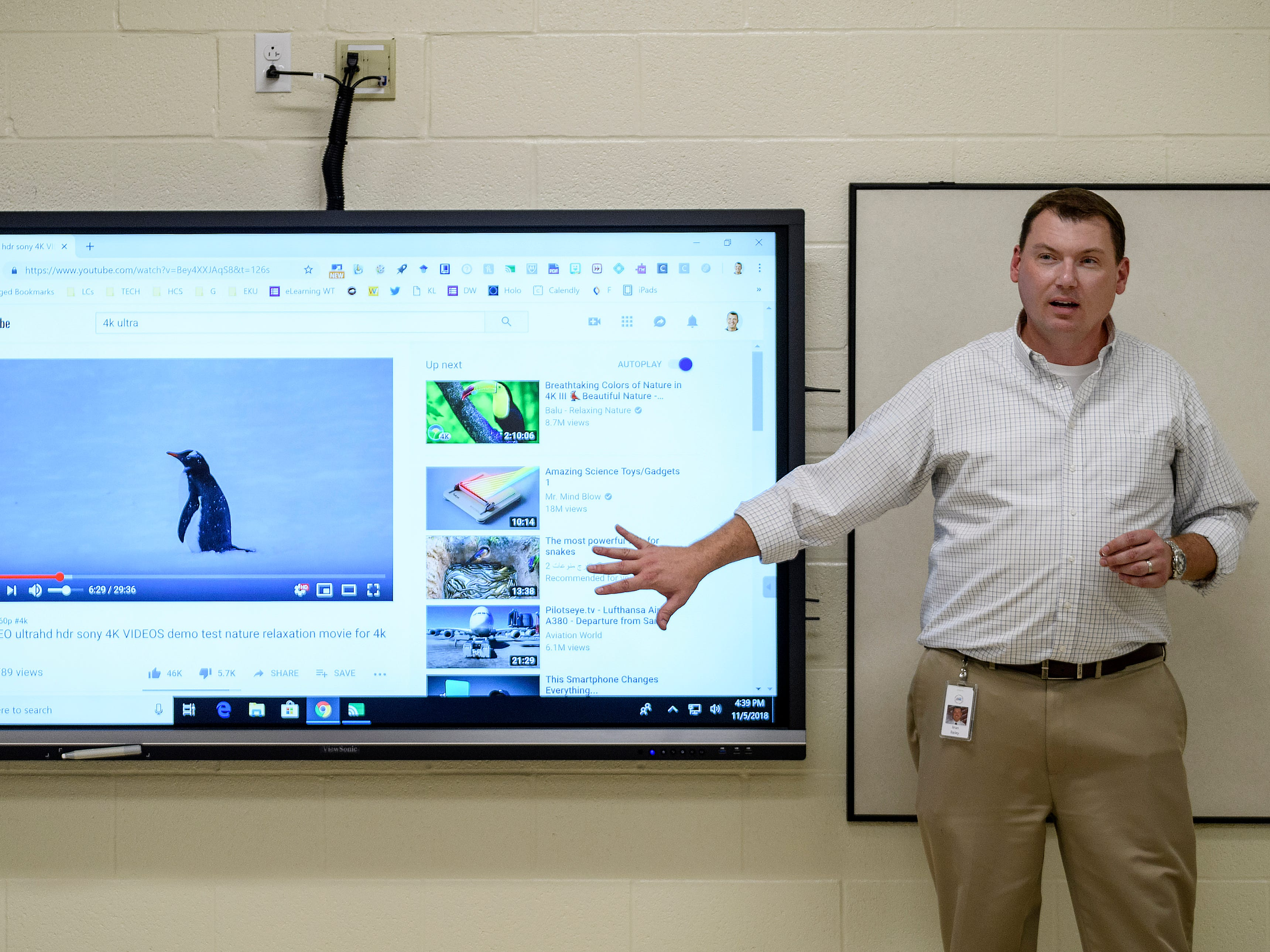 Brian Bailey, Director of Technology for Henderson County Public Schools, shows off the new interactive viewboards that are installed in each classroom during a media tour inside the new Spottsville Elementary School building in Spottsville, Ky., Monday evening, Nov. 5, 2018. The faculty and students are expected to move into the new 76,796 square-foot building next Monday, November 12.