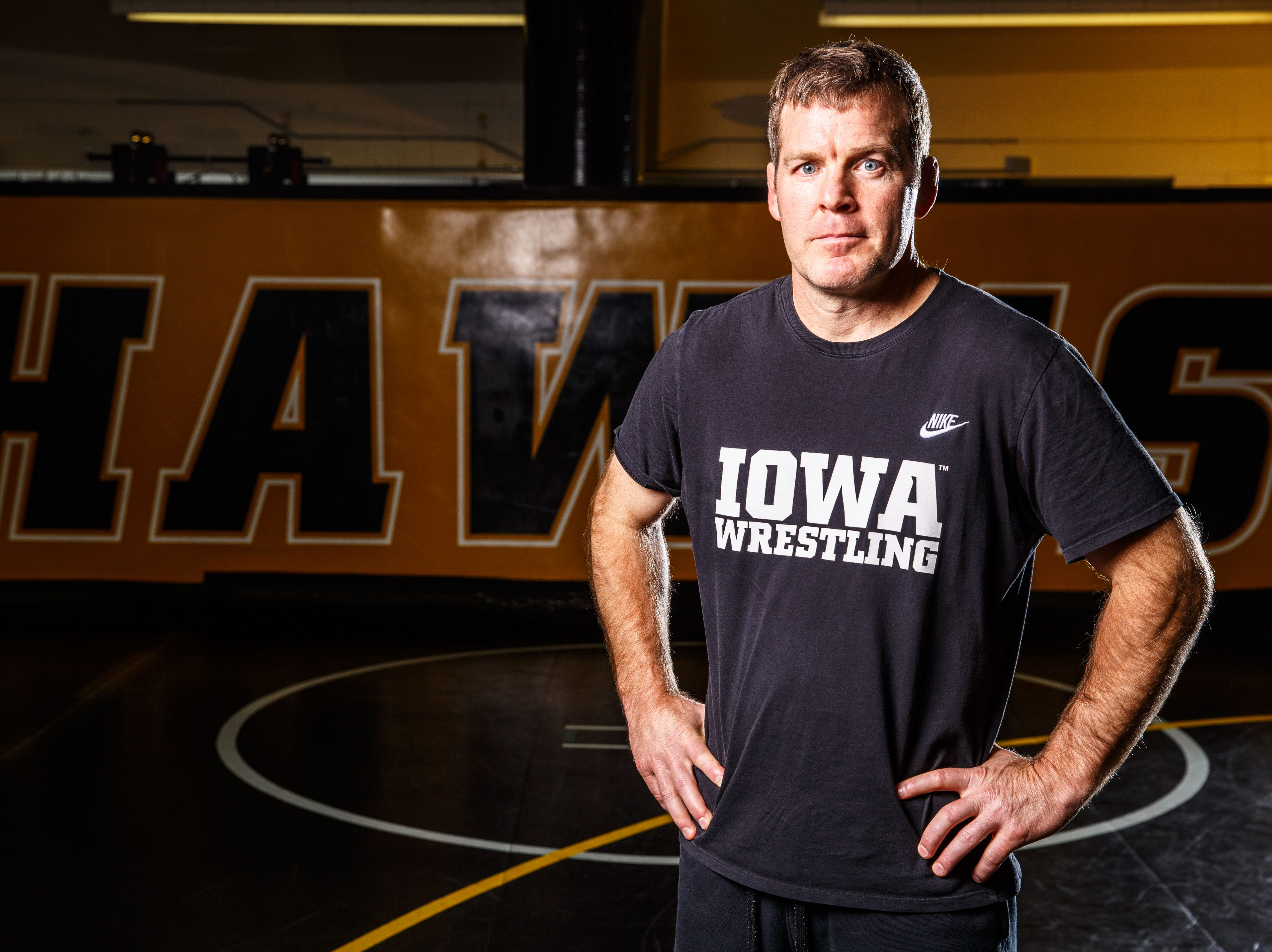 Head coach Tom Brands stands for a portrait during Iowa wrestling media day Monday, Nov. 5, 2018.