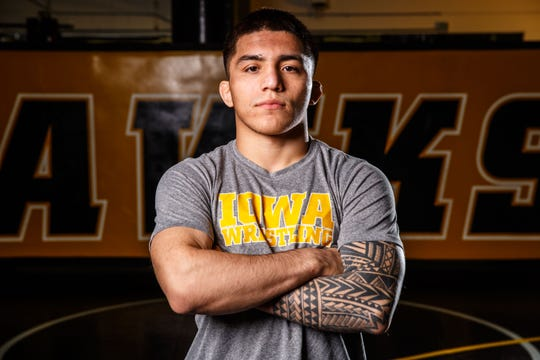 Pat Lugo stands for a portrait during Iowa wrestling media day Monday, Nov. 5, 2018.