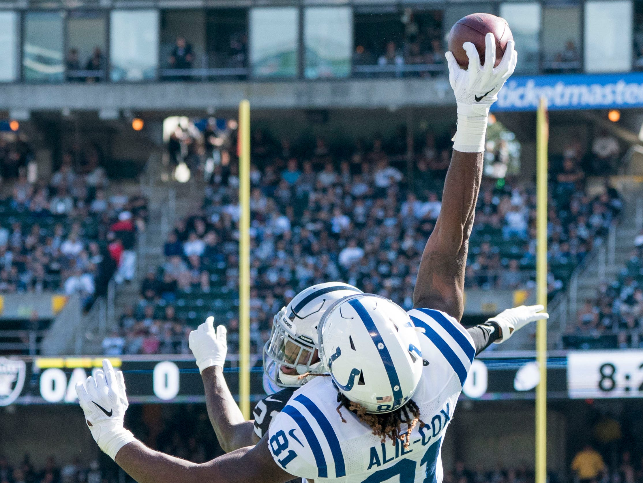 October 28, 2018; Oakland, CA, USA; Indianapolis Colts tight end Mo Alie-Cox (81) catches a touchdown pass against Oakland Raiders cornerback Gareon Conley (21) during the first quarter at Oakland Coliseum. Mandatory Credit: Kyle Terada-USA TODAY Sports