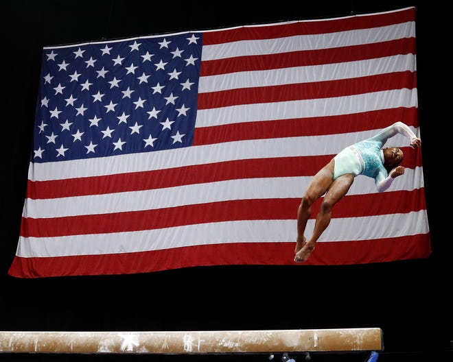 Simone Biles competes on the balance beam during the U.S. Gymnastics Championships at TD Garden.