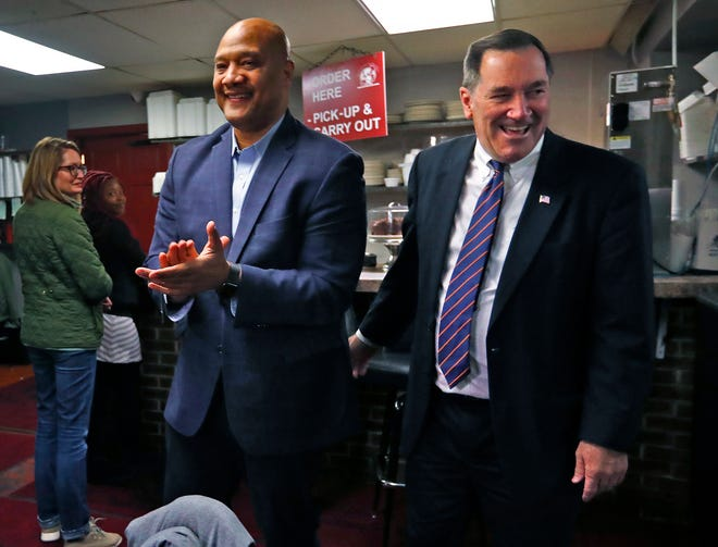 U.S. Congressman Andre Carson, left, gives support to U.S. Senator Joe Donnelly as they both stop by Kountry Kitchen, on election day, Tuesday, Nov. 6, 2018.